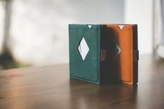 EXENTRI wallets and cardholders provide quick card access with a flick of your thumb. Quality leather, stainless steel and RFID block. For cards, bills and coins. Quick Cards, Green Leather, Emerald Green, Leather Wallet, Card Holder, Stainless Steel, Rolodex, Leather Wallets