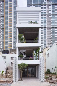 A tall, narrow residence designed to allow daylight to penetrate its walls and floors.