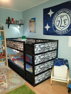 """With a little toddler in the house our boys, 5 and 7 years old have difficulties with building LEGO without disturbance so we got our hands on an old """"Kura"""" bed from Ikea that we painted and we also covered it inwallpaper. On the floor we put a thick mattress and on top we added [&hellip"""
