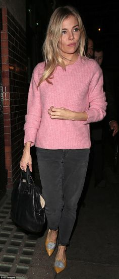 Looking good: On Wednesday evening the star wowed as she left The Apollo following her performance in a candyfloss pink jumper and mustard pumps with a fluffy sky blue pom-pom