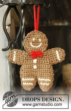 "DROPS Christmas: Crochet DROPS gingerbread man in 2 threads ""Safran"". ~ FREE pattern, oh so jolly! xox ☆ ★  www.pinterest.com/peacefuldoves"
