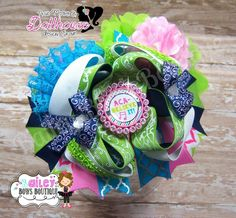 """Aca-Believe It"" Over the top hair bow Just Sayin' An Auction Style Event Opens 3/3/15 at 5 PM CST Closes at 3/5/15 at 9 PM CST Purchase Here: www.facebook.com/dollhousedesigngroup"