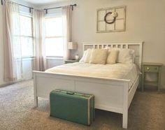 Neutral guest room, white Ikea bed, Behr Silver Drop walls, vintage suitcase, vintage window with wreath Murphy Bed Ikea, Murphy Bed Plans, White Ikea Bed, One Room Flat, Fold Up Beds, Home Instead, Modern Murphy Beds, Neutral Bedding, Extra Bedroom