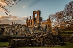 Kirkstall Abbey is a ruined Cistercian monastery in Kirkstall north-west of Leeds city centre in West Yorkshire, England. It is set in a public park on the north bank of the River Aire. It was founded c.1152. It was disestablished during the Dissolution of the Monasteries under the auspices of Henry VIII.
