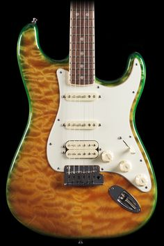 Fender - select Stratocaster hss  - light green/yellow with a reptilian feel.
