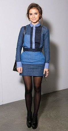 Denim shirt with a denim skirt and black tights and black pumps to dress up the casual fabric
