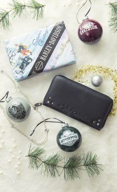 Here are a few gifts ideas for the Harley-Davidson lover in your life. The Zip Around Leather Wallet, the Rhinestone Shield Necklace, and these cute Glass Ball Ornaments would be perfect!