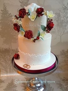 "Two tier wedding cake. Dark chocolate with dark Belgian chocolate ganache filling. Bottom tier extended 6"", top tier 4""."