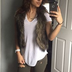 American eagle fur vest Fur vest , size xs , brown color , perfect condition , worn twice , no trades offers welcome American Eagle Outfitters Jackets & Coats Vests