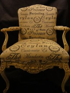 "marvelous chair with gold (and evocative) upholstery (in French I suppose, else ""Ceylon"" is misspelled).  It's a French chair, so."