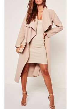 Top any look with this chic, ultra-luxe open-front coat cut for an oversized fit to emphasize the elegantly draped neckline.