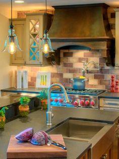 Overhead pendant lights illuminate the kitchen island.