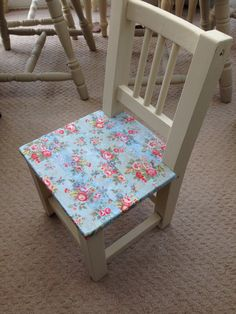 Child's wooden chair painted in Annie Sloan Old Ochre and decoupaged with Cath Kidston's blue trailing flowers