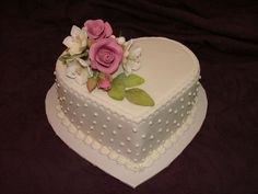 It's a small cake. I was asked by an 80 year old woman to make it for her daughter in law to whom her son is no longer married to , but she stil loves her very much. The flowers are sugar paste flowers.
