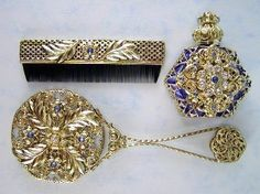 "Czech Victorian Jewelled Vanity Set (Perfume Bottle, Hand Mirror, Comb) Mother's Day Gift by Gabriella's Gifts. $89.99. Bottle Size - 2.5 (H) x 2"" (W), Comb  Size - 3.5"", Hand Mirror Size - 5 3/4"". Decorative Jeweled Vanity Set. Handmade in Czech Republic, gift boxed. Made in Czech Republic. Gold plated decorated with crystals. Great for decoration your bathroom and/or store your favorite perfume or oil. The set is historical replica of traditional old model ma..."