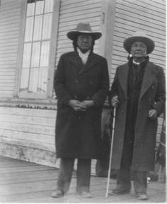 Black and white photo of Eddie Big Beaver and Yellow Kidney posing for a photo in Browning, Montana, 1938