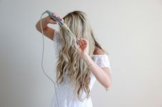 How To:  1. Grab your XO Styling Iron    2. Take the first piece of hair and place it in the flat iron  3. Pull straightener towards you, giving it a half-turn and glide it down  until you reach the end of your hair, then release. (Hold the straightener  horizontally to get more of beachy wave, vertically to get curls.)  4. Repeat through the rest of your hair (I sometimes clip up layers to make  it easier to work through, then let them down as I finish each section)  5. When finished…