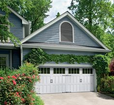Make your neighbors envious of your home's curb appeal by framing your carriage house garage doors with climbing vines.
