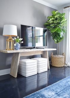 Summer Home Tour + Tips for Simple Summer Living tv wall fiddle leaf fig in basket toulouse ottoman cubes black and white gold bamboo lamp blue vintage inspired rug gray accent wall summer home tour Living Room Tv, Apartment Living, Home And Living, Dining Room, Diy Tv Stand, Simple Tv Stand, Stand For Tv, Blue Tv Stand, Wall Tv Stand