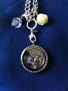 Lia Sofia! LOVE it! WANT it!!!  WANT IT FOR FREE?? Ask me how!   Need Extra Money?  Love Origami Owl ? JOIN MY TEAM!  Designer#14669  Like me on FACEBOOK http://www.facebook.com/oragamitouchedbyacharm SHOP ONLINE @ http://touchedbyacharm.origamiowl.com/