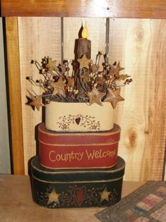 Country welcome stacking boxes---- take the lid off the top one and use it to display a light or arrangement.