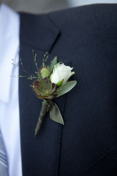Succulent boutonniere.... better out of the pins