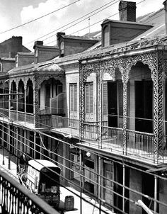 French Quarter notice the horse-drawn ice wagon, 1923. New  Orleans balconies and architecture.