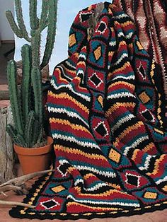 "Afghan is worked in panels using worsted weight yarn and a size G/6 crochet hook. Size: 43 1/2"" x 65 1/2""."
