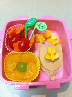 Flower mandarin oranges with grape center, tomatos with a leaf pick and flower carrots. Tulip sandwich and cheese flowers.