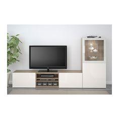 BESTÅ TV-Komb. mit Vitrinentüren - grau las. Nussbaumnachb./Selsviken Hochglanz/Klarglas weiß, Schubladenschiene, sanft schließend - IKEA