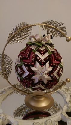 Vintage quilted ornament made of burgundy velvet, olive green satin and shades of cream. Exquisite decoration for a special lady. Made by Angela Fiat Diy Quilted Christmas Ornaments, Quilted Fabric Ornaments, Hand Painted Ornaments, Beaded Ornaments, Handmade Ornaments, Ball Ornaments, Christmas Balls, Green Satin, How To Make Ornaments