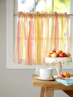 ribbon curtains hanging in the window - so pretty!