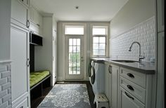 mudroom/ laundry room but with rods for hanging clothes