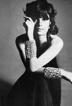 Actress Marisa Mell is wearing a gown of black crepe falling from a single slanted diamantè strap by Helga, jewelled cuffs by Robert Originals, photo by Bert Stern, Vogue US 1967