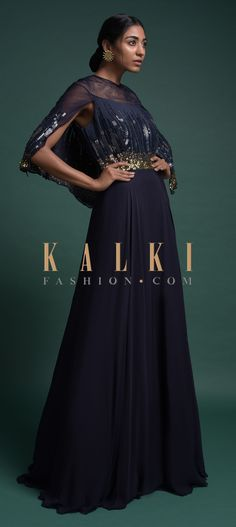 Buy Online from the link below. We ship worldwide (Free Shipping over US$100)  Click Anywhere to Tag Midnight Blue Indowestern Gown In Georgette With An Attached Cape Online - Kalki Fashion Midnight blue indowestern gown in georgette with an attached cape.Embellished with sequins work on the bodice and cape.Crafted with illusion neckline.