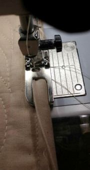 how to use a flat fell foot to machine stitch binding ~~aha! I get it now!~~