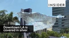 The silver cloud, called Liquid Shard, is floating above Pershing Square. Patrick Shearn of Poetic Kinetics made it out of silver streamers.