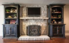 Build in the TV - with bookcases, fireplace, TV...this could be done efficiently with the new lightweight 'stone.'