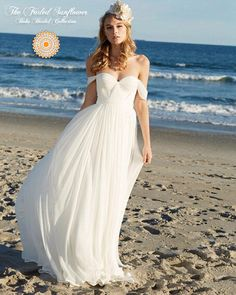 Soft, flowing layers of chiffon envelop you in this gorgeous boho-chic beach wedding gown.  The sweetheart neckline is cross ruched and tucked chiffon that accentuates all the right curves. The off shoulder cap sleeves at a sexy touch and a simple natural waist line and sweep train complete a sim...