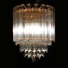 An elegant 1970's five tier Italian crystal glass chandelier. The chandelier features heavy geometric crystal prisms, most likely made by Venini for Camer. The original 'Murano, Italy' label remains on the chandelier. Image © Eclectisaurus. Visit our shop at 249 Gerrard St E, Toronto. 416-934-9009 www.eclectisaurus.com