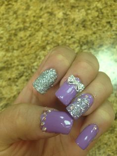 Very cute nails with diamonds ,glitter, and a bow