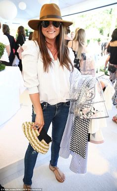 Garden girl: Tiffani Thiessen was the epitome of laid back chic, donning a handsome blouse...