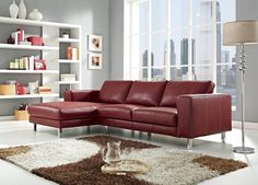 This elegant red leather sofa is made with a solid wood frame, chromed stainless steel legs and upholstered in leather.  It's a simple design that's plenty formal for a living room.