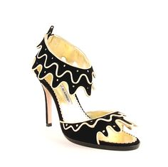 Fabulous black suede leather is trimmed playfully with gold. The scalloped trim makes this shoe one to remember with gold dots in the middle of each scallop. The sandal-like straps have two separate layers for extra detail and skirt-like appearance. Be bold and make a statement in these fabulous Blahniks!  Approx: 4 inch heel