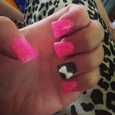 Pink sparkly nails with bow