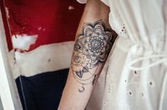 Mandala and rose on the inside of the arm