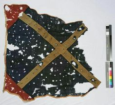 Flag fragment, containing a St. Andrews Cross, made by the ladies of Asheville for the men of the 39th Regiment, NC Troops and presented to the Regiment in May 1862.  In the collections of the NC Museum of History, Raleigh.