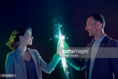 Businesspeople connecting through light : Stock-Foto