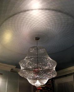 Paper Clip Chandelier - WOW, what a cool idea. (Be sure to watch it on Youtube.com - Paperclip chandelier)  Neat idea.