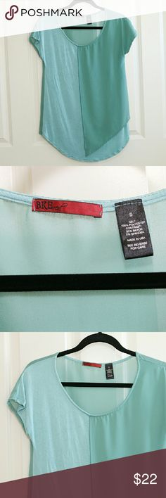 Buckle BKE Red Blouse Teal Size S Buckle BKE Red blouse.  Teal, size small.  NWOT.  Longer in front.  About 17 inches armpit to armpit.  About 29 inches shoulder to hem. Buckle Tops Blouses